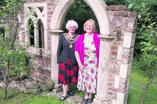 This Is Wiltshire: arol Gibbons, who opened her garden for Prospect Hospice, was joined by Mayor Theresa Page as she offered supporters of the charity a behind-the-scenes glimpse