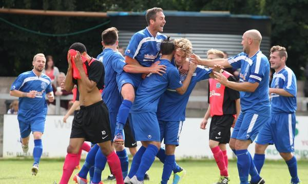 This Is Wiltshire: Alex Ferguson is mobbed after scoring Chippenham Town's opener on Saturday (Picture by Robin Foster)