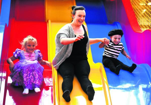 This Is Wiltshire: Leah, Amy French and Darim have fun on the slide