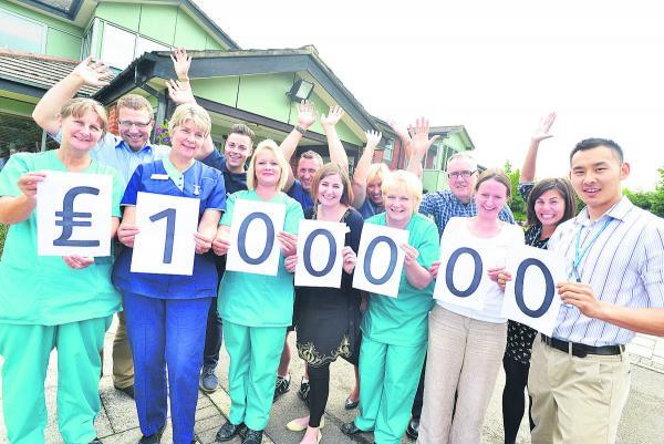 This Is Wiltshire: Staff at Prospect celebrate the £100,000 milestone