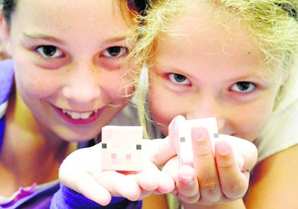 This Is Wiltshire: Minecraft papercraft at The Museum of Computing. Pictured are Isabel and Sydney with their creations