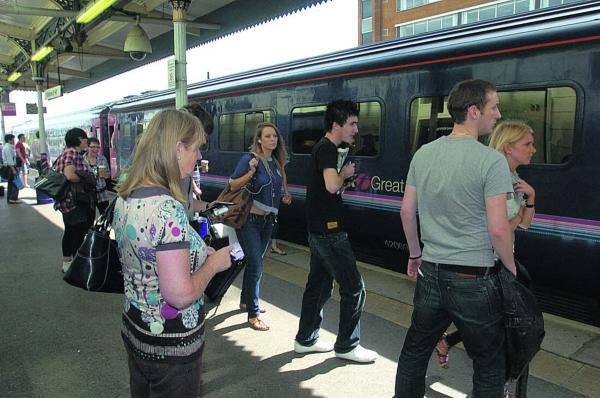 This Is Wiltshire: Boarding a First Great Western train at Swindon. The company was voted one of the country's least trustworthy in a survey