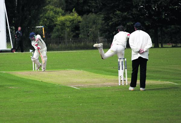 This Is Wiltshire: Wootton Bassett's Jay Baden bowls to Swindon Civil Service's Dan Ellis