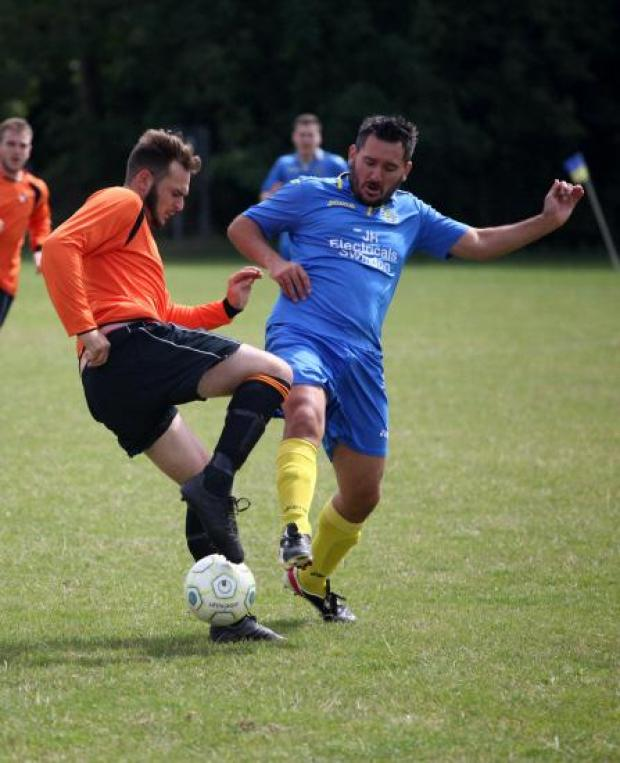 This Is Wiltshire: Bassett's Richard Clark battles with Adam Mercer, of Trowbridge Wanderers
