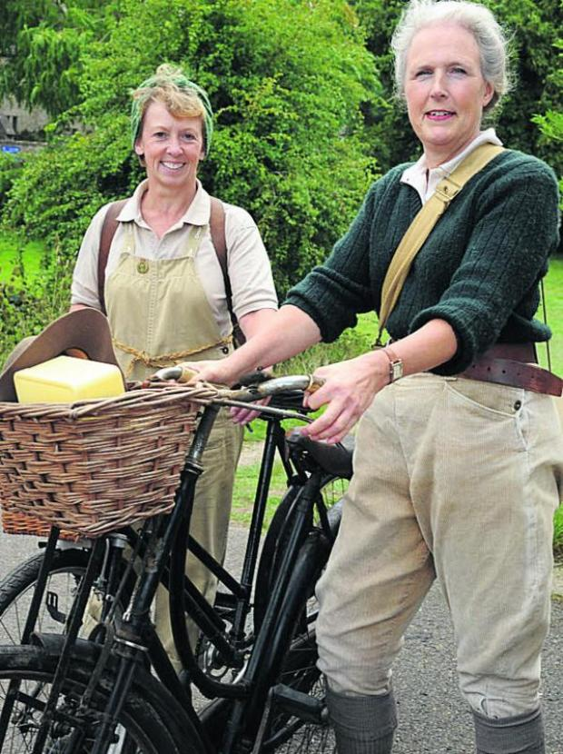 This Is Wiltshire: Trowbridge duo Bronwen Jones and Kate Spanswick as land girls arrive at Lacock at War. Picture Trevor Porter