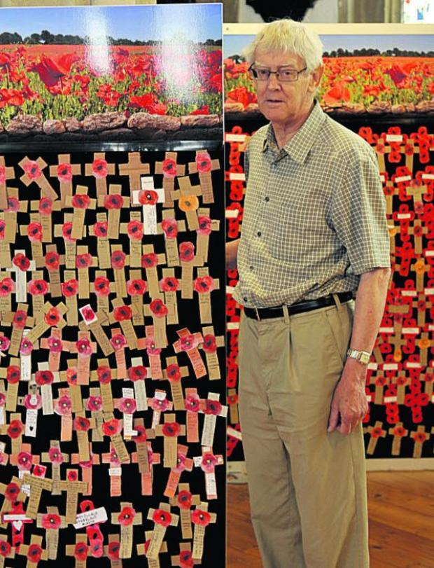 This Is Wiltshire: Arthur Broom was one of those to find the exhibition of 10,000 crosses at St Peter's Church, Marlborough, moving. Picture by Siobhan Boyle