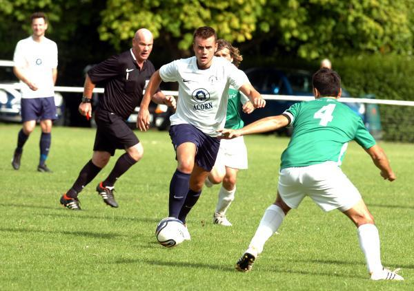 This Is Wiltshire: Tom Ballard gets on the ball during Pewsey Vale's FA Cup defeat last weekend