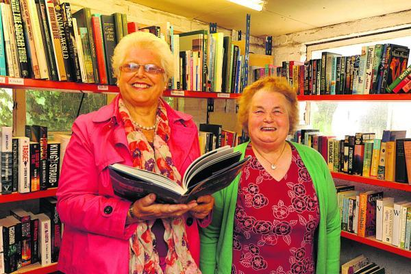 This Is Wiltshire: Pat Cridland and building owner Jean Harris in the Urchfont pop-up book shop                                                   (PM1418) By Paul Morris