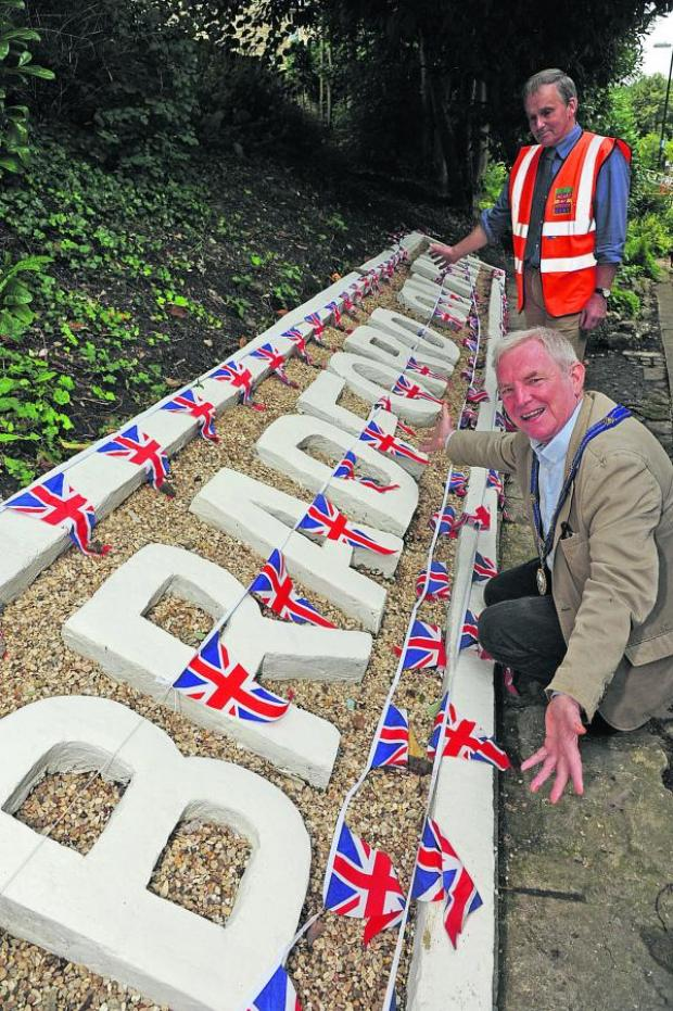 This Is Wiltshire: Mayor John Potter with Simon Meade King who made  new concrete sign at Bradford on Avon Station