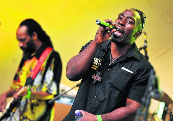 This Is Wiltshire: Macka B and the Roots Ragga Band stir it up at last year's Reggae Garden Festival at the Town Gardens Bowl