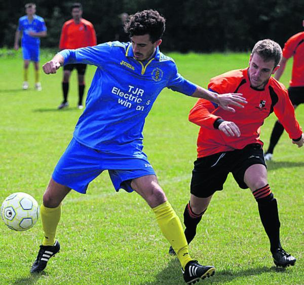 This Is Wiltshire: Trowbridge Wanderers' Steve Fox (right) tracks Wootton Bassett Town Deve