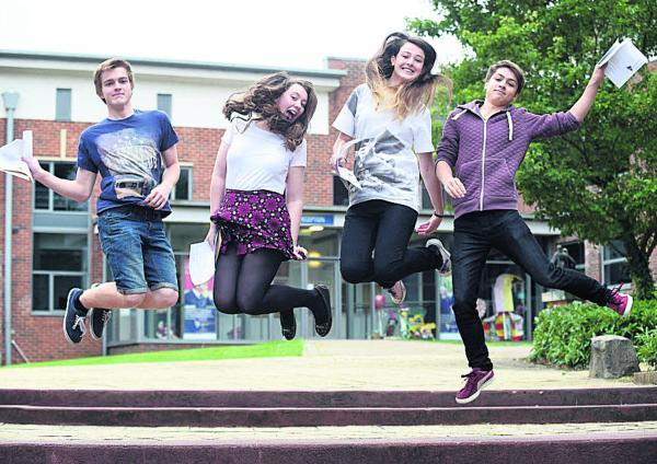 This Is Wiltshire: Daniel Foster, Caoimhe Kelly, Danielle White and Reaze Enright, from John Bentley School celebrate their GCSE results. Picture by Diane Vose