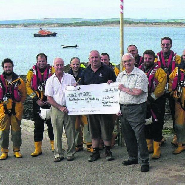 This Is Wiltshire: From front left are Geoff Wilford – Master Benevolence Lodge, Martin Cox – coxswain for Appledore Lifeboat and David Glaholm – Master Wiltshire Summer Lodge