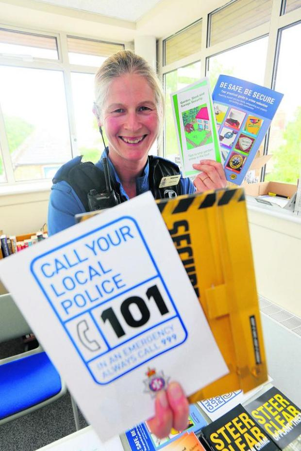 This Is Wiltshire: Juliet Evans, the PCSO for Rural North Swindon with crime prevention information which was on show at community drop-in session at Highworth Library