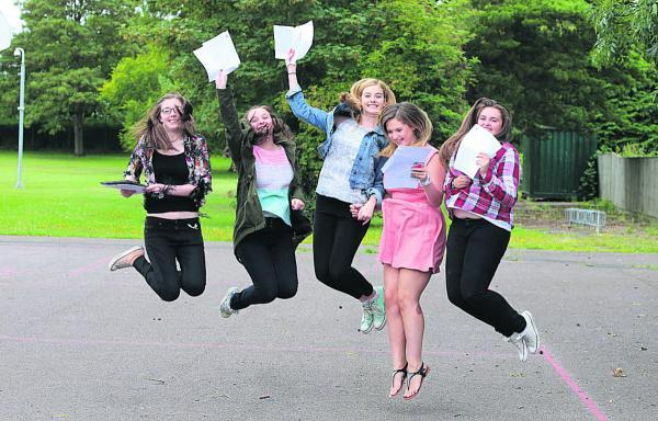 This Is Wiltshire: Pupils from Kingsdown School celebrating their GCSE results on Thursday morning. Left to right, Lauren Waters, Kiera Beardsell, Lucy Jenkins, Mairead O'Shea and Hannah Luker