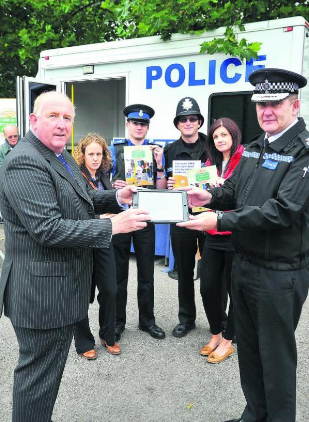 This Is Wiltshire: Police and Crime Commissioner Angus Macpherson, Claire Woods, Phil Butwell, Stephen Yates, Katrina Fleet and chief constable Pat Geenty at the launch of the new police messaging system