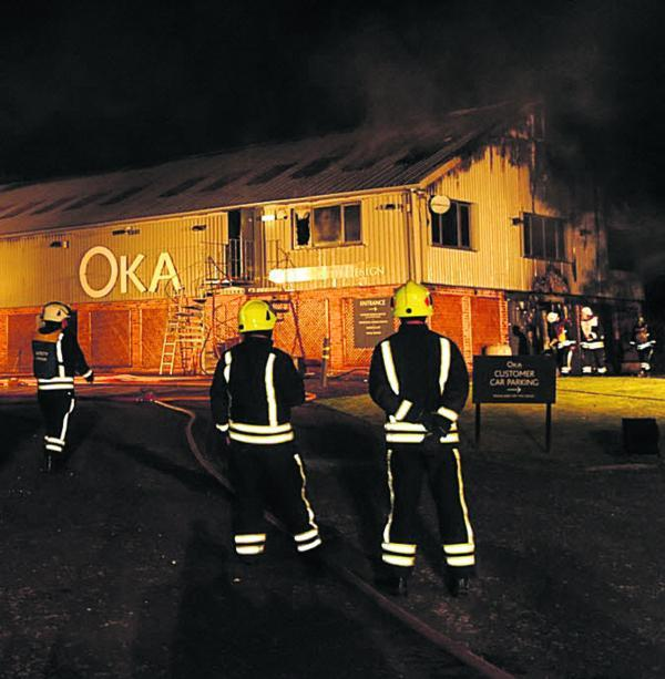 This Is Wiltshire: Firefighters at furniture warehouse Oka. Picture by Paul Morris