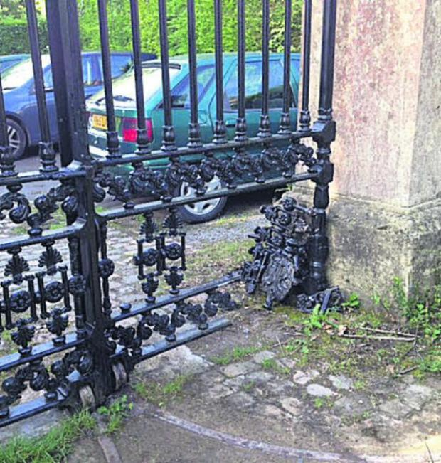 This Is Wiltshire: The damage caused to the restored gates at Quakers Walk