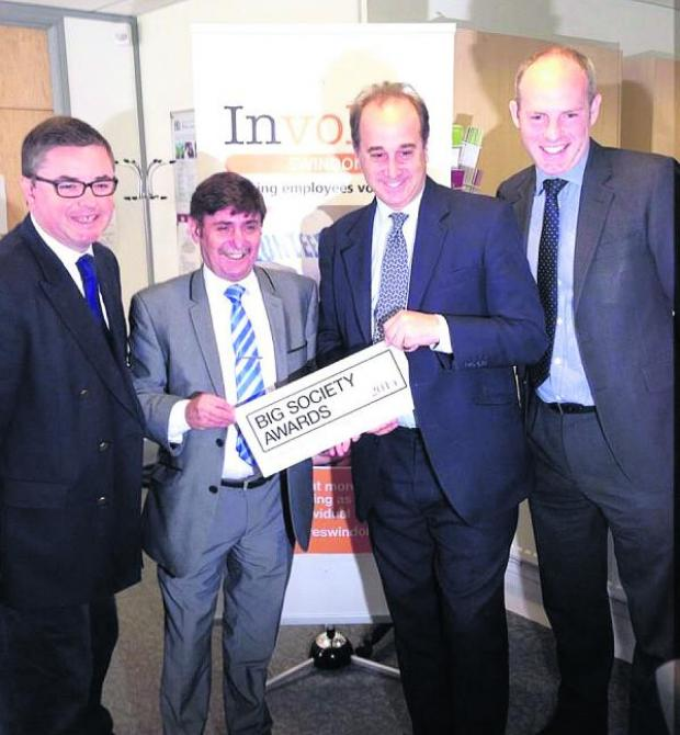 This Is Wiltshire: Second from left Tony Martin, the UK volunteer manager, of Zurich Community Trust and the Chairman of Involve Swindon accepts The Big Society Award from the cabinet minister for Civil Society, Brooks Newmark with Swindon MPs Robert  Buckland and Justin To