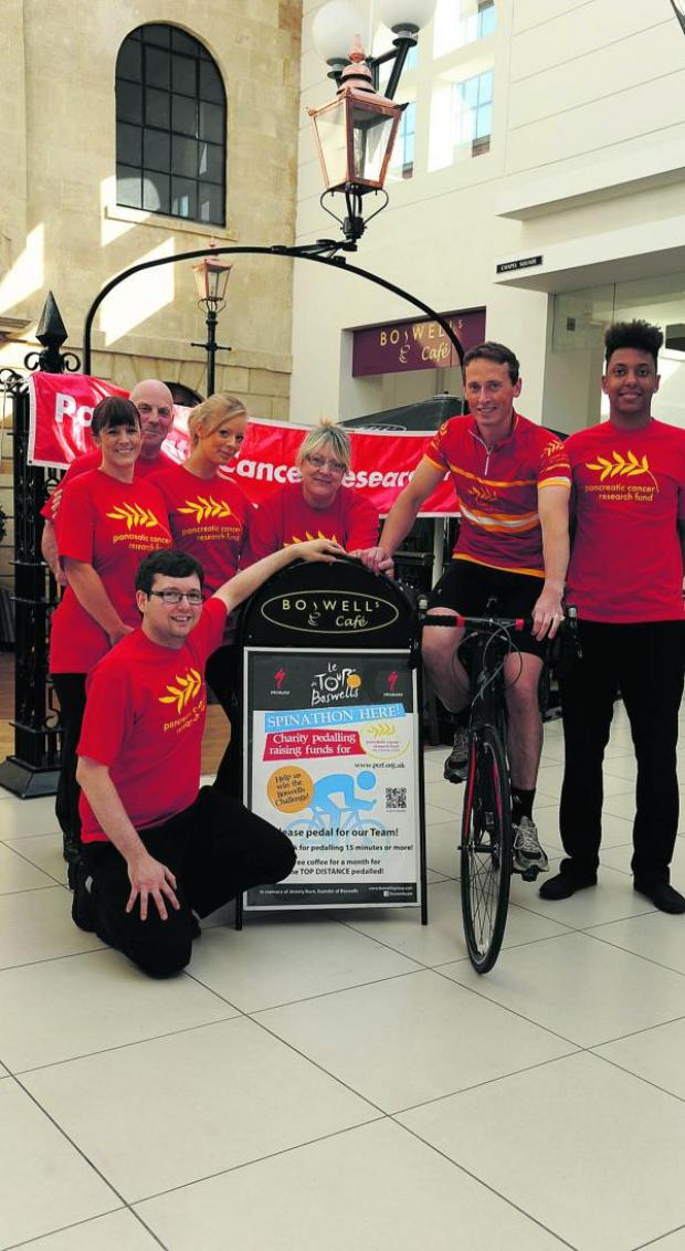 This Is Wiltshire: Boswell manager Harrison Carter, director Matt Burn on his bike and staff in promoting their spinathon