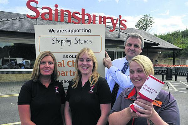 This Is Wiltshire: Sainsbury's Bradford on Avon manager Neil Laver with colleague Bridgette Humm, front, whose son has benefited from the charity, and Teresa Blake, left, and Sarah Cottle from Stepping Stones