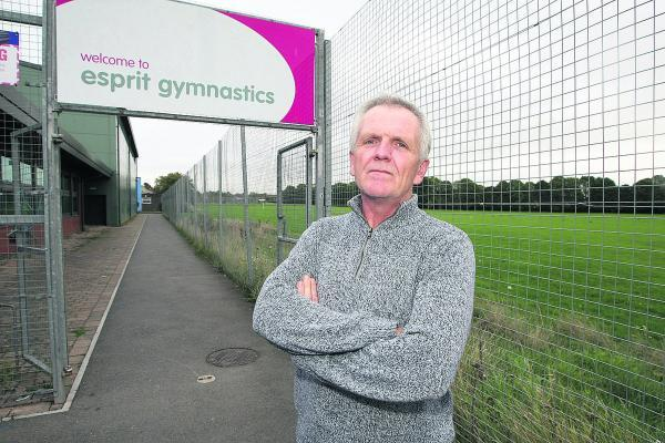 This Is Wiltshire: Mark Hows, chairman of Esprit Gymnastics in Stratton, at the site earmarked for 150 new homes – a plan he says urgently needs rethinking
