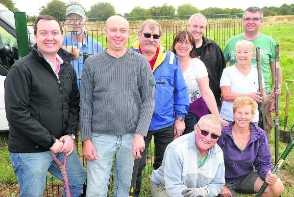This Is Wiltshire: Residents and councillors prepare to set up fencing around the new Nythe Allotments