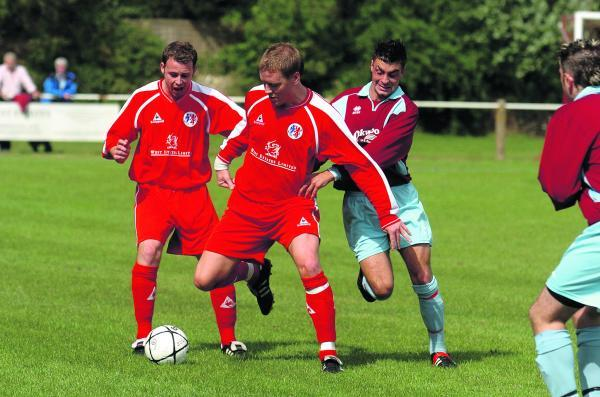 This Is Wiltshire: Fairford boss Gareth Daviespulled back on the red shirt on Saturday and scored, he's pictured here in his last