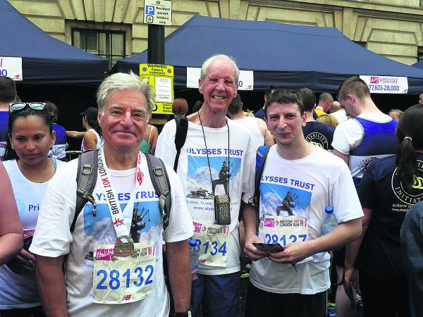 This Is Wiltshire: Philip Neame, left, and his team after the 10k race to raise funds