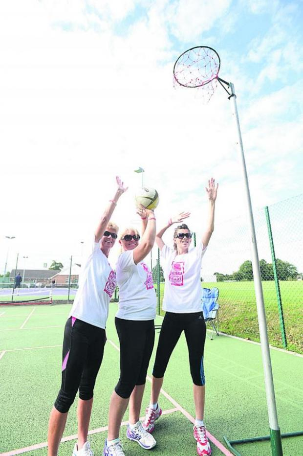 This Is Wiltshire: Trudie Procter, Nikki Chambers and Ella Harding shoot hoops at Devizes Sports Club. Picture by Diane Vose