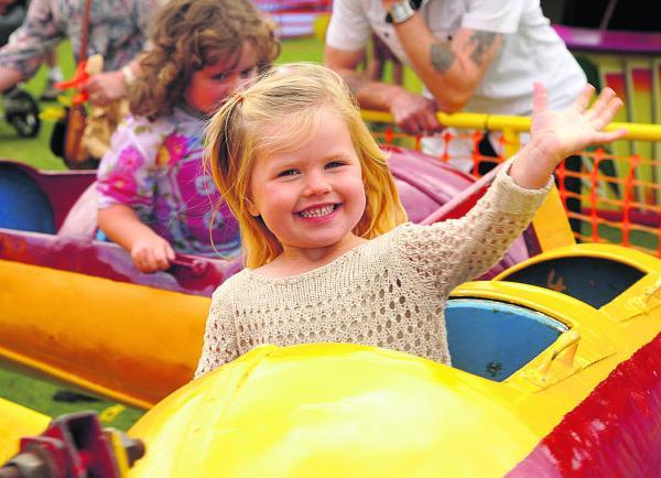 This Is Wiltshire: Evie Pike enjoys herself at the Shrivenham Village Fete
