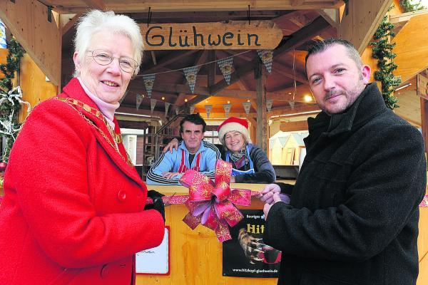 This Is Wiltshire: Former Mayor Ray Ballman, former CEO on inSwindon Simon Jackson and German stall owners Bruno Girardea and Sonia Luther-Schreiber at a previous Christmas market