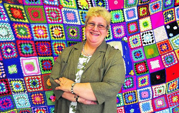 This Is Wiltshire: Jane Young with the blanket she knitted in aid of Help For Heroes