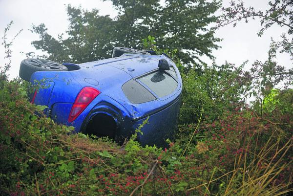 This Is Wiltshire: The car which came off the A361 from Wroughton and landed in a hedge