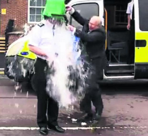 This Is Wiltshire: Chief Constable Pat Geenty is drenched by Angus Macpherson, Wiltshire and Swindon Police and Crime Commissioner, in the Ice Bucket Challenge