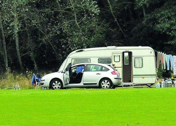 This Is Wiltshire: Travellers who were staying in Lydiard Park have now moved to Shaw Forest Park, Mead Way       Picture: Vicky Scipio