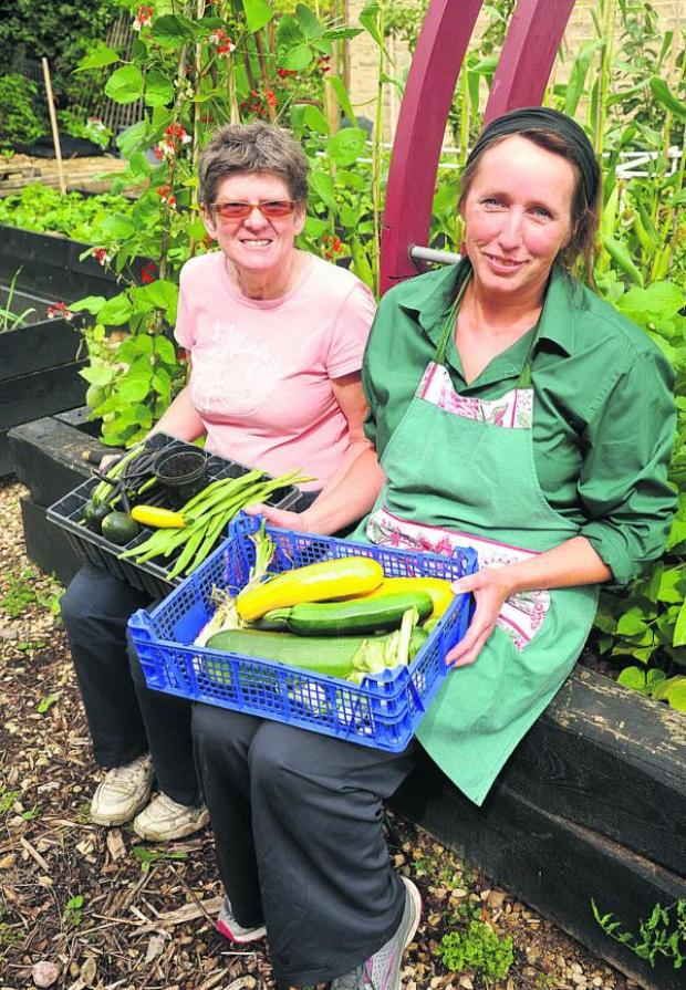 This Is Wiltshire: Phyllida Richards, Twigs' senior supervisor, right, with Steph Perry at the Manor Garden Centre. The charity  received £3,000 grant in 2010