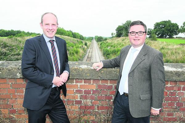 This Is Wiltshire: Swindon MPs Justin Tomlinson and Robert Buckland pictured at the redoubling work site