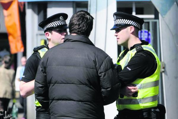This Is Wiltshire: Police question a man in the street