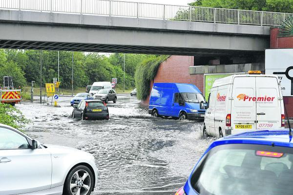This Is Wiltshire: Flooding at Bruce Street Bridges, which will hopefully be alleviated by the roadworks