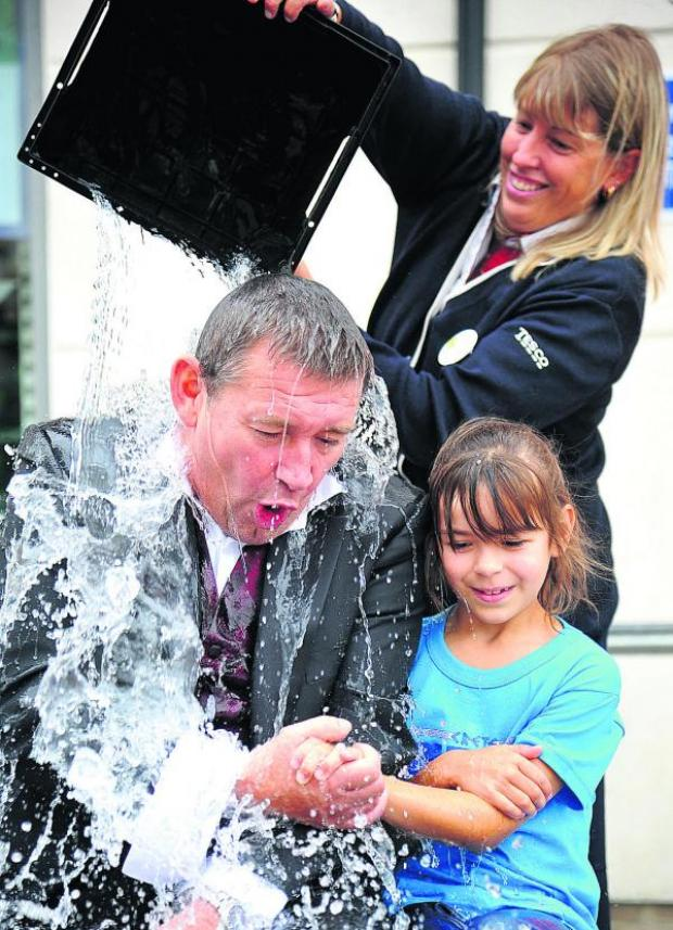 This Is Wiltshire: Freezer jolly good fellow –Nathan Neate is given an icy blast by Lou Langston, while Bethy looks on