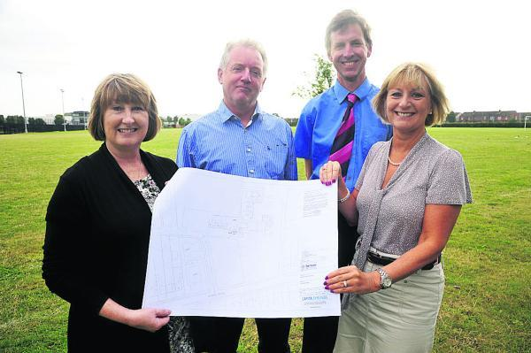 This Is Wiltshire: Tony McAteer, prospective head of Holy Cross Primary School, with Jayne Rutherford, Foundation Stage Leader, Robin Cristian, Deputy Headteacher and, far right,  Beverly Briggs, Business Manager