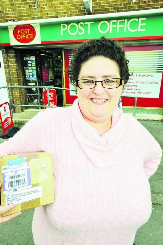 This Is Wiltshire: Employee Barbara Linton at Upper Stratton Post Office, which is having a makeover