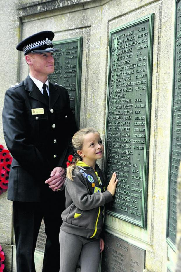 This Is Wiltshire: Inspector Matthew Armstrong and Brownie Hattie McVey, who both took part in the service