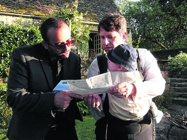 This Is Wiltshire: Nicola Juha-Moussalam shows Duncan Hames his one month permit which enabled him to visit Jerusalem, five miles from Bethlehem, last Easter