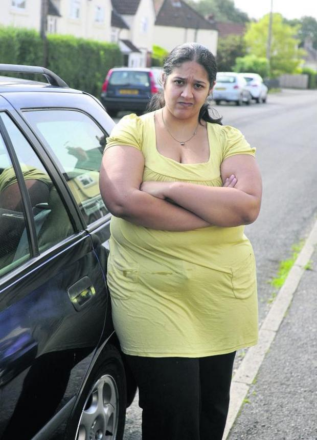 This Is Wiltshire: Sabrina Vinden is one of 15 people who had their cars vandalised by paint wielding yobs in Chippenham on Friday night. Police are appealing for witnesses. Picture by Siobhan Boyle