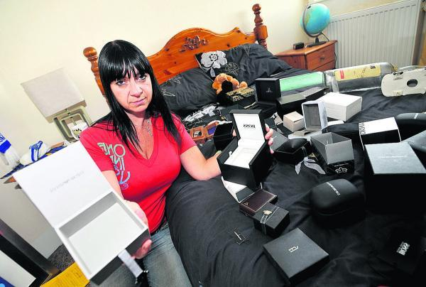 This Is Wiltshire: Burglary victim Ayshea Matthews with her empty jewellery boxes