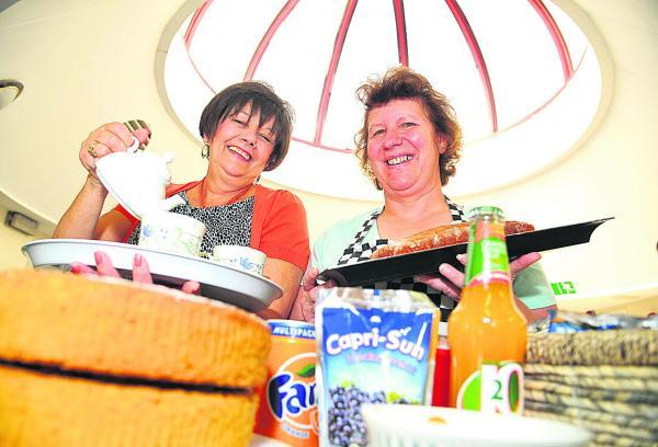 This Is Wiltshire: Sylvia Dowling and Clare Stow at work behind the counter at Options for Living cafe