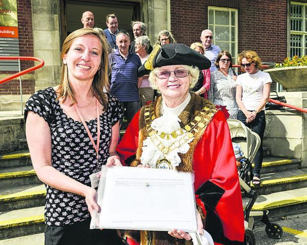 This Is Wiltshire: Old Town councillor Nadine Watts, handing a petition for Croft Fields to Swindon Mayor Teresa Page