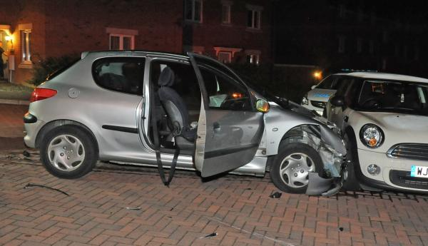 This Is Wiltshire: The Peugeot which rolled into the stationary Mini following a collision with a Fiat 500 on Thestfield Drive, Staverton. Picture by Trevor Porter